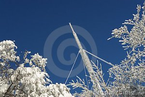 communication-tower-covered-with-snow-stock_photo_by_vlad_baciu