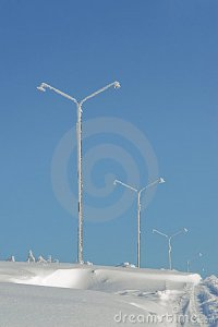 frozen-light-poles-covered-with-snow-stock_photo_by_vlad_baciu