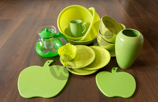 stock-photo-green-dishes-on-a-dark-wood-floor
