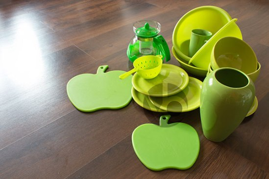 stock-photo-green-dishes-on-a-dark-wooden-parquet