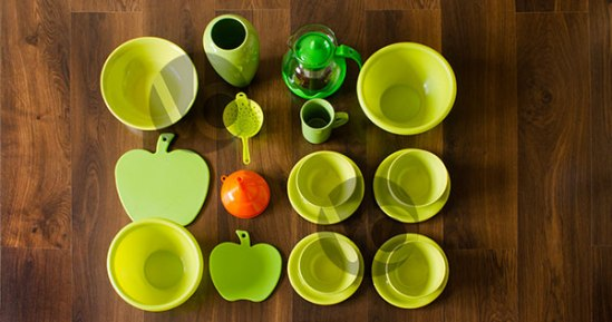 stock-photo-green-dishes-top-view-with-an-orange-funnel