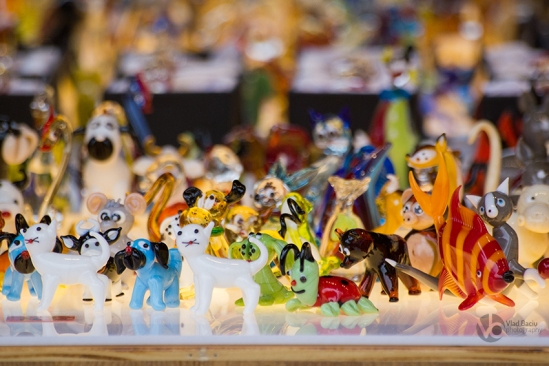 Colored-glass-figurines-in-shape-of-cat-and-dog-and-fish-and-lady-bug