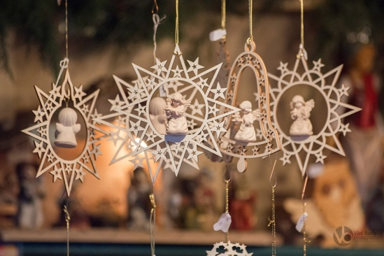 Star-shaped-and-bell-shaped-wooden-Christmas-ornaments-with-small-angels_